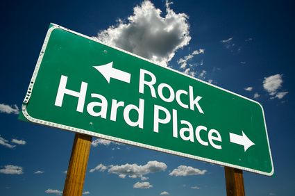"""""""Rock, Hard Place"""" Road Sign with dramatic clouds and sky."""