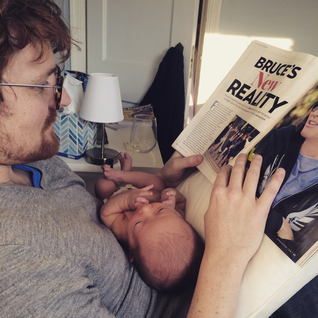 Daddy reading baby a story... about Bruce Jenner's transition to becoming a woman.