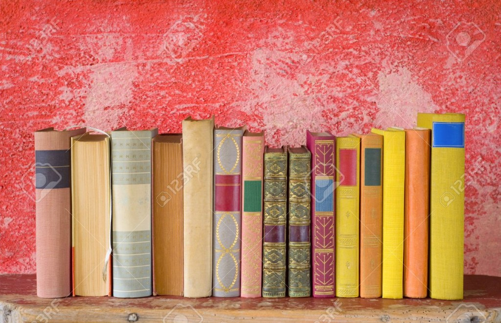 row of books, free copy space on red background